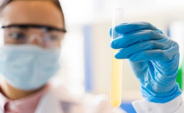 defocused-female-scientist-holding-lab-substance.jpg
